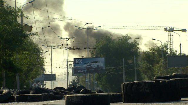 smoke rising over bridge to Donetsk airport
