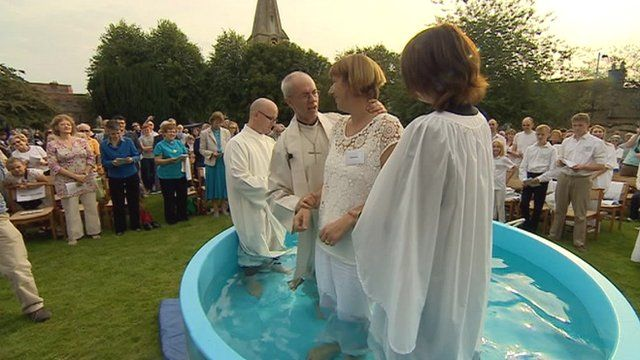 Archbishop Justin Welby performs an open-air baptism at Malmsbury Abbey, Wiltshire