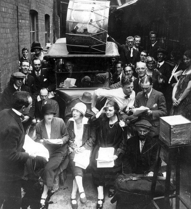 Tyrone Guthrie in bow tie and white shirt making an outside broadcast in Linenhall Street in 1928