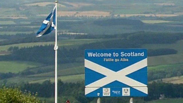 Saltire and Welcome to Scotland sign