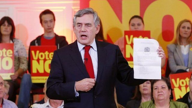 Gordon Brown holds a page from the Scotland Act 2012 during a campaign event