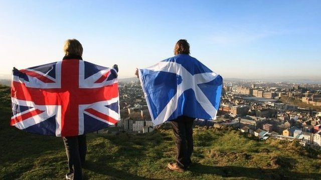Scottish and UK flags held up over Edinburgh