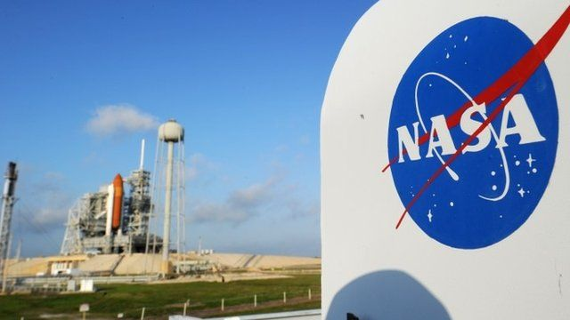 The NASA logo near the space shuttle Endeavour at the Kennedy Space Centre in Florida.