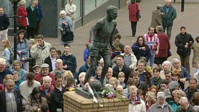 Crowds gathered by the Sir Stanley Matthews statue in Stoke-on-Trent