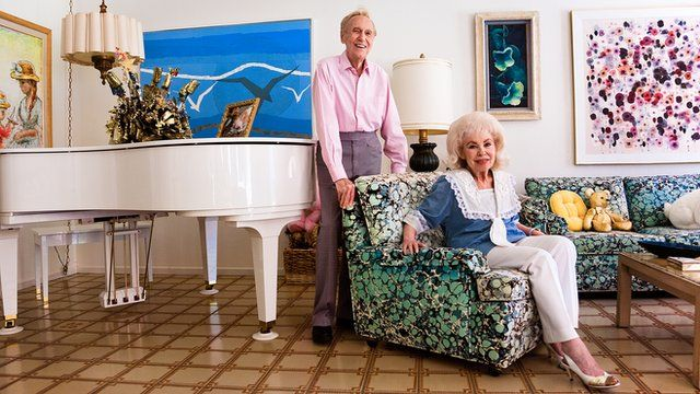 Photograph of a couple in their living room in Palm Springs