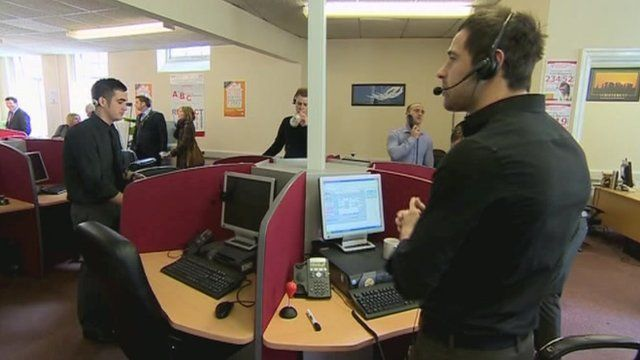 Call centre staff standing up to do their jobs