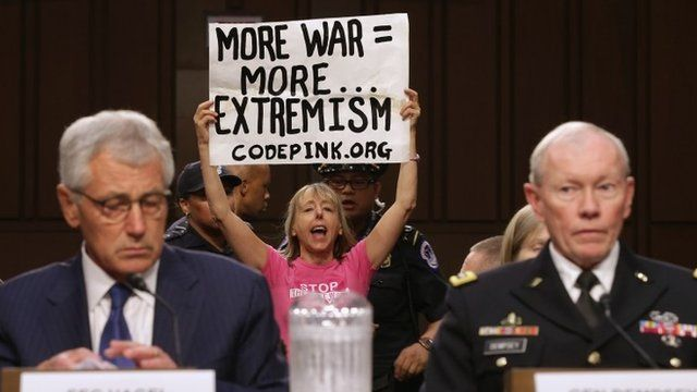 Code Pink co-founder Medea Benjamin protests at a hearing with Chuck Hagel and Martin Dempsey