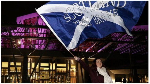 woman with saltire outside Holyrood