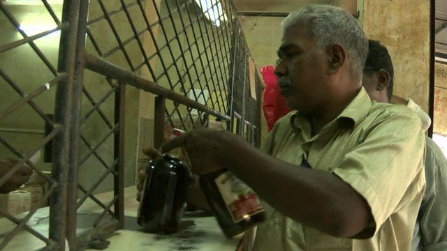 Man buying alcohol in Kerala