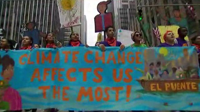 Demonstrators in New York with a banner reading 'Climate change affects us the most'