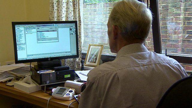 GP at a computer