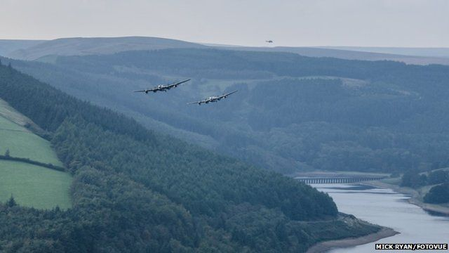 Two Lancasters flying over Derwent reservoir