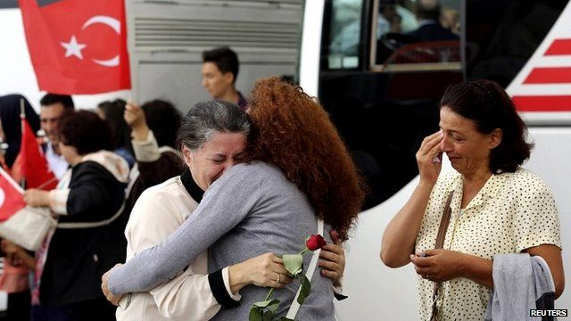 An employee at Turkey's consulate in Mosul is welcomed by her relatives in Ankara on 20 September 2014