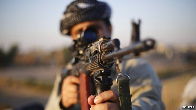 A Kurdish Peshmerga fighter observes the front line with Islamic State, in Gwar, northern Iraq