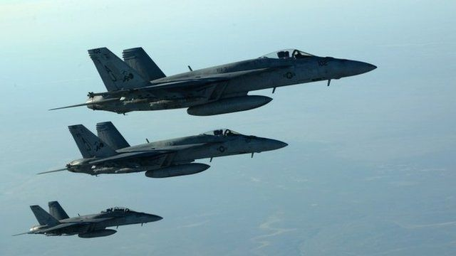 a formation of US Navy F-18E Super Hornets in flight after receiving fuel from a KC-135 Stratotanker over northern Iraq, on September 23 2014