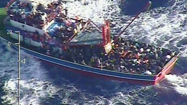 Fishing trawler overloaded with people in the Mediterranean Sea