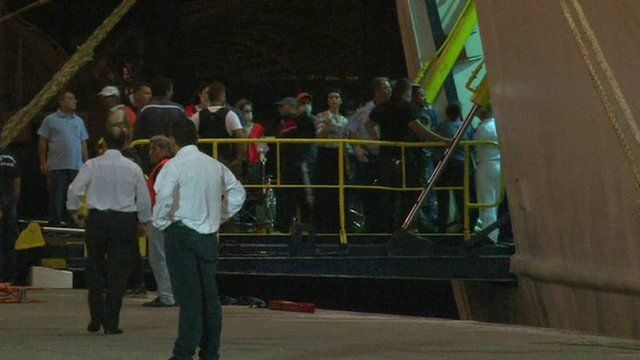 Syrian refugees disembark from a cruise ship