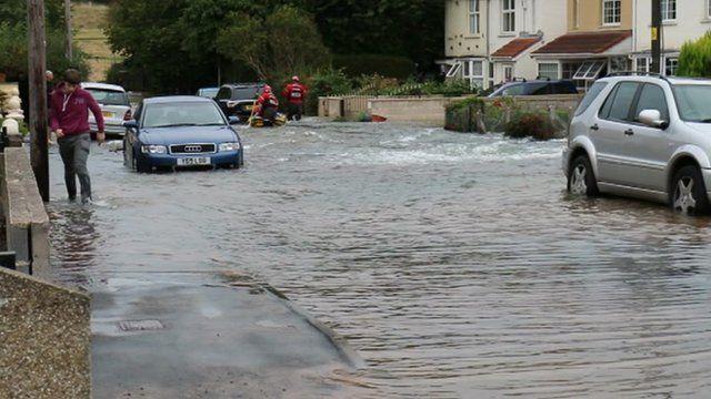 Water floods road