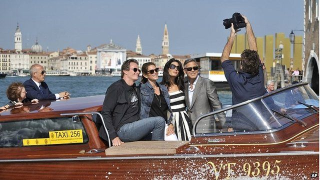 George Clooney and Amal Alamuddin on a water taxi ride in Venice