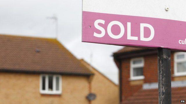 Estate agent's sold sign