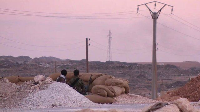 Kurdish fighters on alert in Kobane