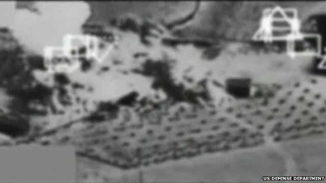 Black and white footage showing air strike on Kobane