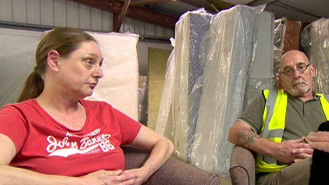 Furniture warehouse workers Sue and Martin