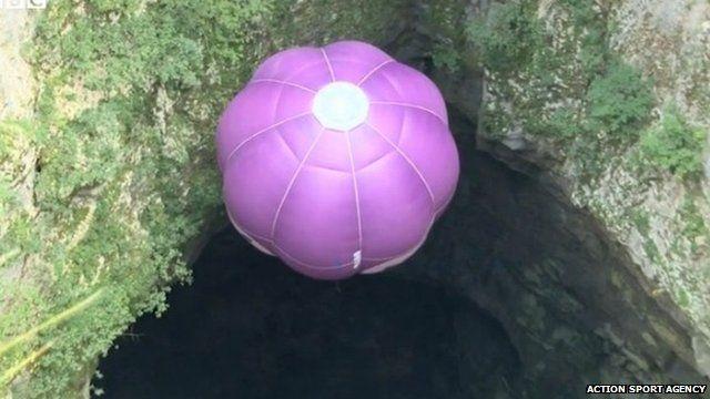 Austrian balloon pilot Ivan Trifonov descends into cave