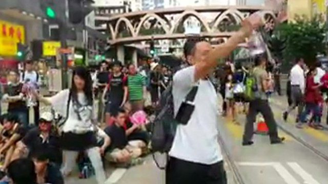 Protesters spraying water