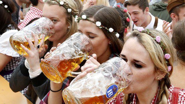 Visitors enjoy beer during visit to Oktoberfest