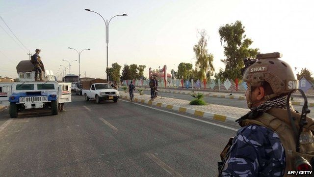 Iraqi security forces man a checkpoint in the northern city of Kirkuk