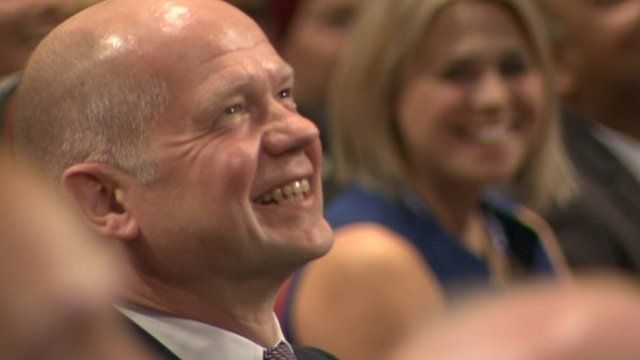 William Hague listens to David Cameron mimicking him