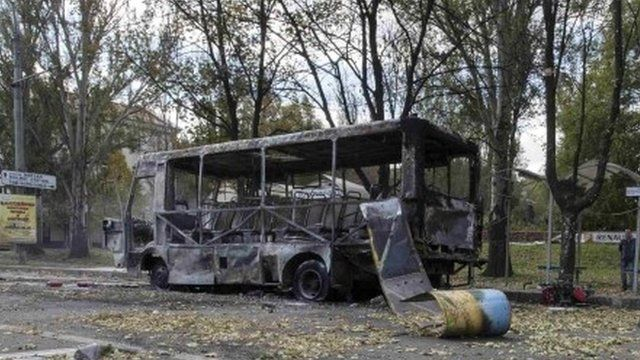 A mini-bus damaged in the shelling