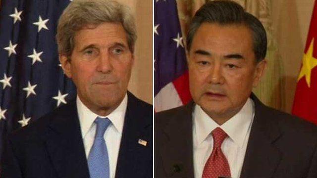 John Kerry and Wang Yi