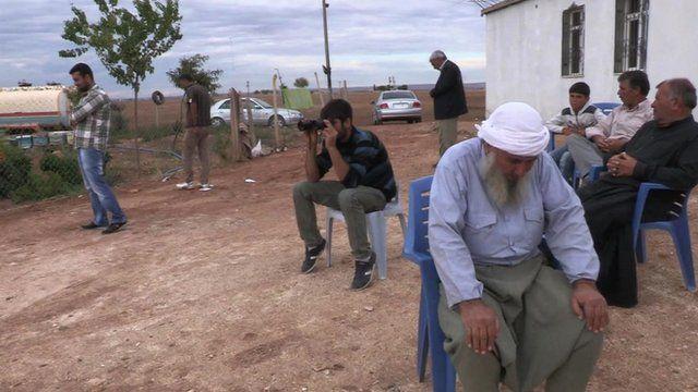 Refugees outside house