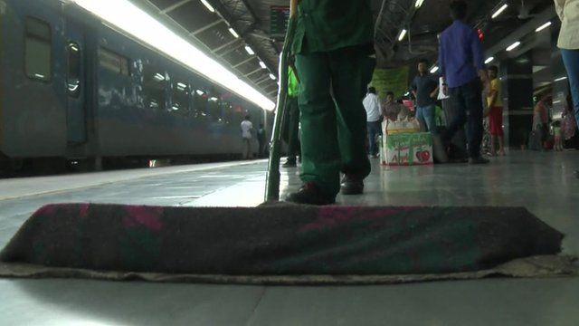 Broom sweeping railway platform
