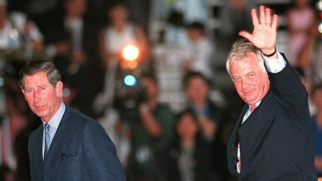 """Former Hong Kong Governor Chris Patten (R) waves to wellwishers as he boards the Royal Yacht Britannia accompanied by Britain""""s Prince Charles"""