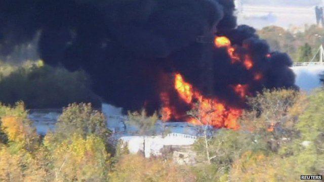 Black smoke billowing from burning refinery near Donetsk airport