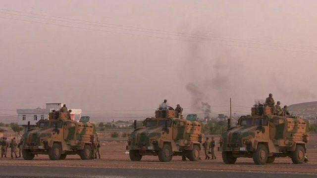 Turkish tanks face away from border town Kobane