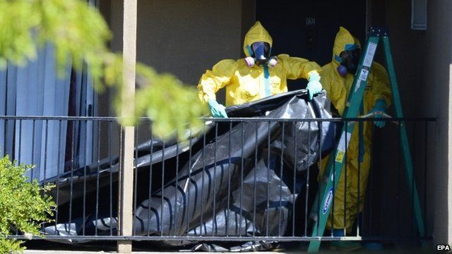 US Ebola case: Texas flat sealed by Hazmat team