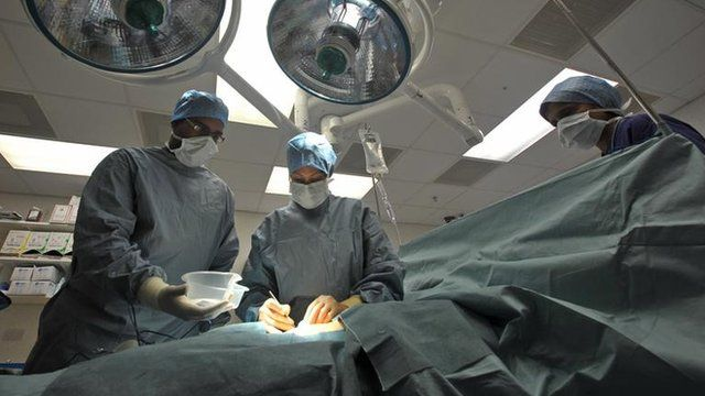 Surgeons working in an operating theatre