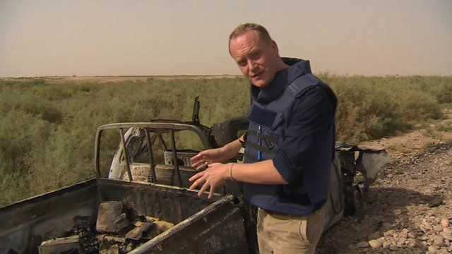 The BBC's Quentin Sommerville inspects an Islamic State vehicle loaded with explosives