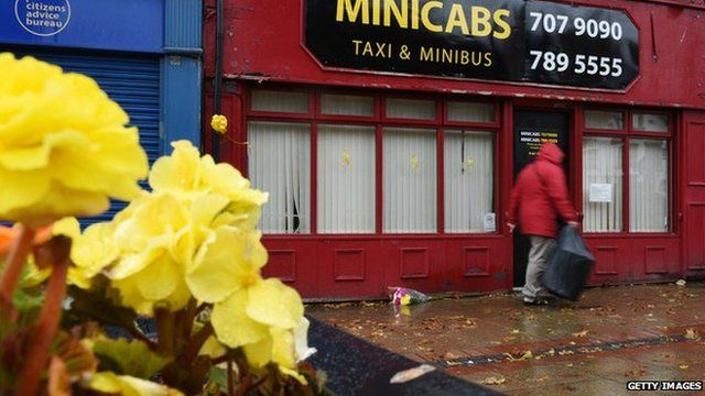 Flowers outside the taxi office where Mr Henning used to work