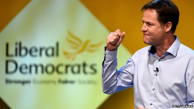 Nick Clegg addresses delegates at an evening rally on 4 October