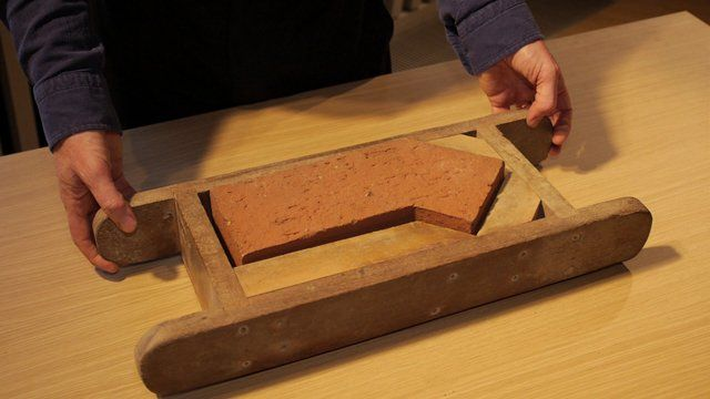 John Tuomey holds a special brick mould