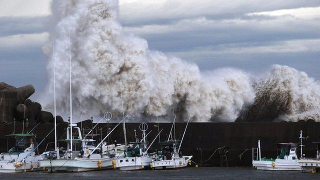High waves batter a breakwater at a port in central Japan
