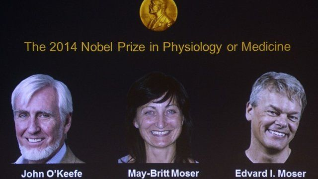A screen displays the winners of the 2014 Nobel Medicine Prize