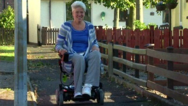 Andrea Brown tries out her donated electric wheelchair