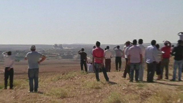 People watch Kobane