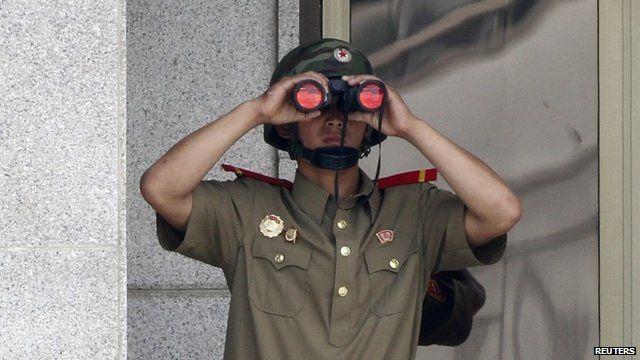 North Korean soldier with binoculars